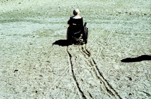 Wheelchair on the Beach, by Kris Krug (CC)